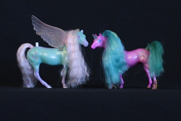 Meri & Shala; <h2>Meri</h2> Body Color:Teal and Purple <br/>Hair Color: Pink<br/>Breed: Pegasus Pink Wings<br/>Symbol: 3 Pink Hearts<br/>Brush: Purple<br/> Accessories: 2 Medium Purple Ribbons<br/>Notes: Tail Braided <h2>Shala</h2>  Body Color: Hot Pink<br/>Hair Color: Turquois<br/>Breed: Unicorn Teal Horn<br/>Symbol: I'm not sure what they actually are, but there are three pointy horseshoes with a bump on top<br/> Accessories: 2 Hot Pink Ribbons<br/>Notes: <br />Trading Card Story: Meri is the most artistic and creative of the Fillies. She loves to tell wild stories of her adventures in the sky and to make beautiful hairstyles on the other Fillies. Shala, her best Unicorn friend, always is available to let Meri style her hair! She loves the attention she gets when she models the new style!
