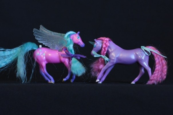 Storm & Zoe; <h2>Storm</h2> Body Color: Dark Pink and Purple<br/>Hair Color: Teal <br/>Breed: Pegasus Clear (maybe very pale Teal)<br/>Symbol: 3 Teal 5-point Stars <br/>Brush: Teal<br/> Accessories: 2 Dark Purple Ribbons<br/>Notes: <h2>Zoe</h2>  Body Color: Purple<br/>Hair Color: Dark Pink <br/>Breed: Unicorn Clear (maybe very light Teal) Horn <br/>Symbol: White Sparkles and Dots <br/> Accessories: 2 White Ribbons <br/>Notes: Tail in a twisted Braid. <br/>Trading Card Story: Storm likes to fly at the speed of lightening. Her powerful wings cause great gusts of wind to whip around the Unicorns on the ground. Zoe and the other Unicorns love to chase and play with the leaves and flowers that fall from the trees. Zoe's crystal horn reflects the lightening causing a beautiful spectrum of colors.